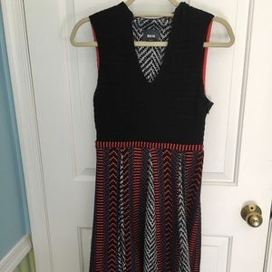 Black, red and white sleeveless dress.